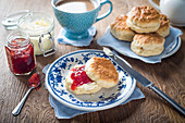 Scones with strawberry jam and clotted cream and tea