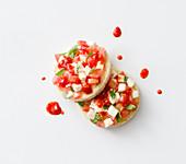 Crostini with tomato and mozzarella salad