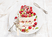 Homemade semifreddo with pistachio and raspberry