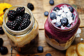A blueberry and banana smoothie with yoghurt, and a banana and mango smoothie with chocolate and blackberries
