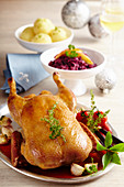 Roasted duck with herbs, red cabbage and potato dumplings