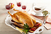 Roasted goose for Christmas dinner filled with apple stuffed and served with apple wedges