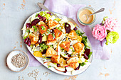Salad with beets, apple and fried camembert