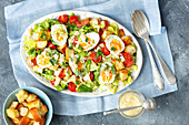 Salad with egg, cherry tomatoes, croutons and home made mayo