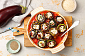 Aubergine and courgette rolls with feta cheese in tomato sauce