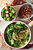 Brussels sprouts, savoy cabbage and broccoli with pomegranate seeds, and nuts for Christmas