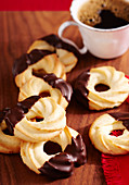 Shortbread piped orange biscuits with chocolate glaze for Christmas