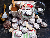 Snow Caps: dark chocolate cookies with powdered sugar for Christmas, and a cup of coffee