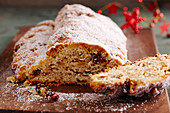 Fruit stollen on a wooden board, sliced