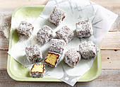 Sponge cake bites with chocolate glaze and grated coconut (New Zealand)