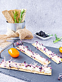 Rosemary crackers with cream cheese and sprouts
