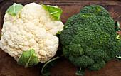 Cauliflower and broccoli on wood cutting board