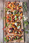 Pizza with pear, biltong, tex-mex mix, beetroot and aubergine