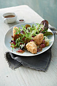 Red lamb's lettuce with nut-coated Brie, fried grapes and a fig-mustard dressing