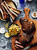 Beef steak, fries and marrow bones