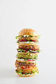 A veggie burger tower with various different patties