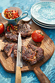 Steak with grilled tomatoes and lentil salad
