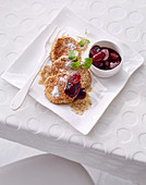 Sweet quark pancakes in a crunchy coating with red grapes