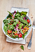 Wild herb salad with tomatoes and radishes