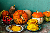 Autumn still life with pumpkins and pumpkin pancakes