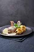 Veal sirloin with lemon and tagliatelle