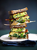 Spring onion and bacon frittata sandwiches and fried herbs