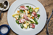 Chicory salad with lamb and croutons