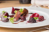 Wild duck with blackberries and beetroot