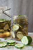 Sliced Pickling Cucumbers Marinating in Vintage Glass Jars