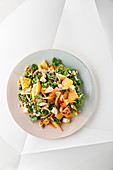 Autumnal kale salad with persimmon and halloumi