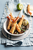 King prawns in a quinoa coating on soya and sesame seed sauce