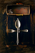 Food art: an arrangement of cutlery on a brown surface (inspired by Joseph Beuys)