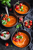 Creamy tomato soup with noodles and baked cherry tomatoes