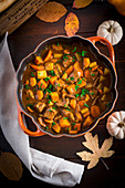 Irish stew with pumpkin and guinness in a pumpkin cocotte