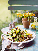 Zucchini quinoa salad with candied walnuts and haloumi