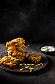 Onion bhajis with yoghurt rajta