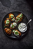 Hasselback potatoes with sour cream and chives