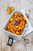 Red lentil pasta with turmeric, cherry tomatoes, carrots and buckwheat (low carb lunch)