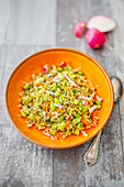A salad with edamame, quinoa, radishes and amaranth pops