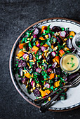 Roasted pumpkin and beet salad with tahini dressing
