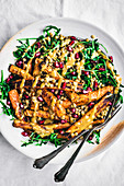 Roasted carrots with tahini lentil salad and arugula