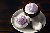 Lavender ice cream served at the halves of cracked coconut