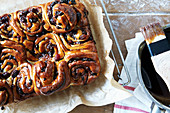 Chelsea Buns on cooling rack with glaze
