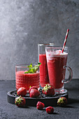Three different smoothies with watermelon, strawberry, raspberry, pomegranate