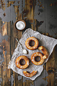 Homemade puff pastry deep fried donuts or cronuts in stack with sugar