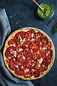 Tomato tart on blue background
