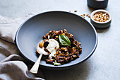 Eggplant caponata in blue bowl