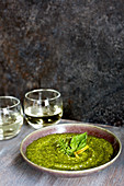 Lemon Basil Pesto served with bread, walnuts and white wine