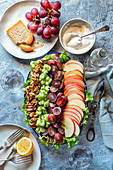 Deconstructed Waldorf salad with celery, apple, grapes and walnuts on a plate