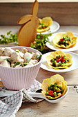 Chicken ragout in a cream sauce with vegetables in potato baskets for Easter brunch